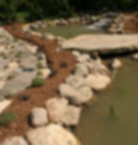 Large Pond With Stone Bridge And Biofalls