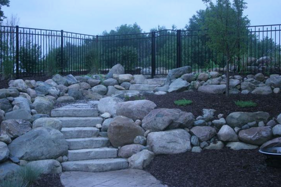 Sideyard Hill Landscaped With Boulder Retaining Walls and Steps