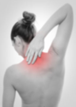 Highlighted spine of woman with back pai