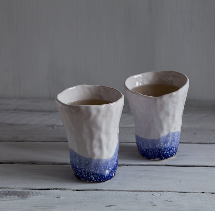 tea in ceramic cups, blue and white hand
