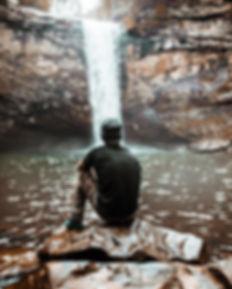 man looking at waterfall blake-cheek.jpg