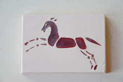 Tile with a horse