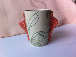 tea mug with leafs and red snail