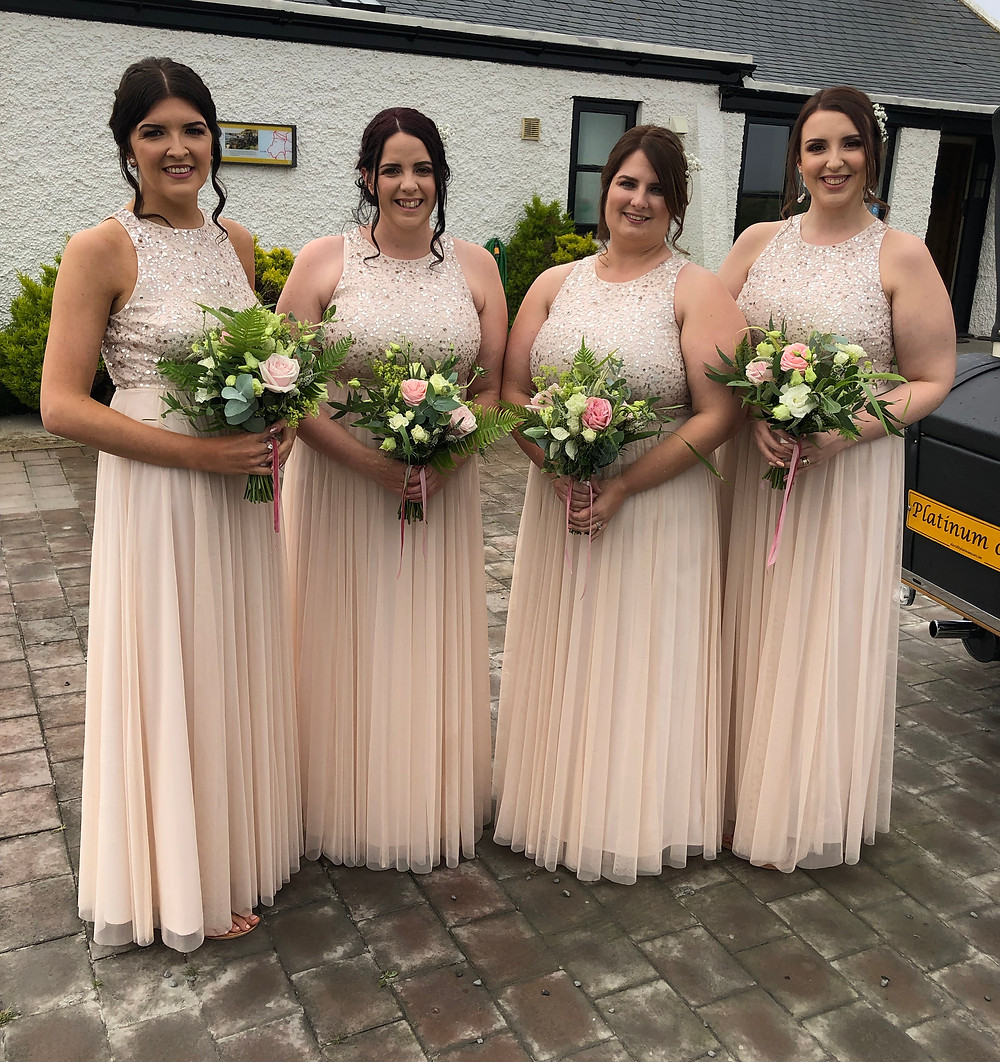 Bridesmaids with pink roses