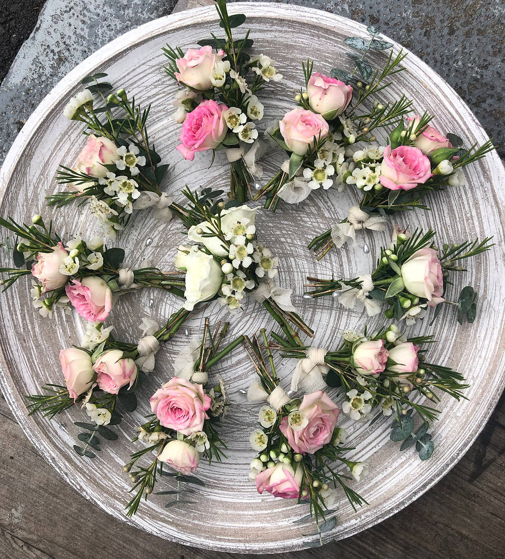 Pink and white rose buttonholes