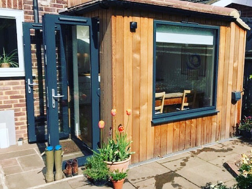 Pretty little cedar clad kitchen extension in London