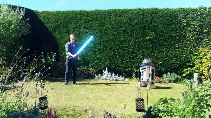 R2 Shoots Lightsaber