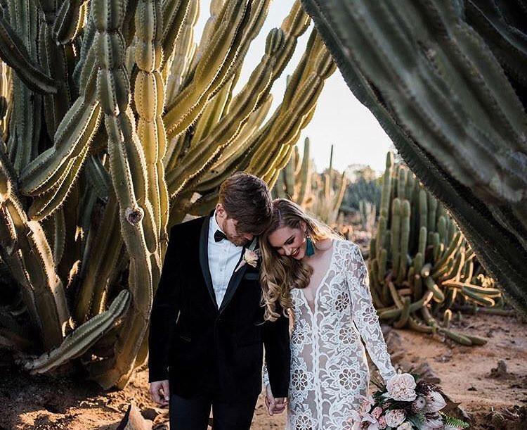 couple withhuge cacti