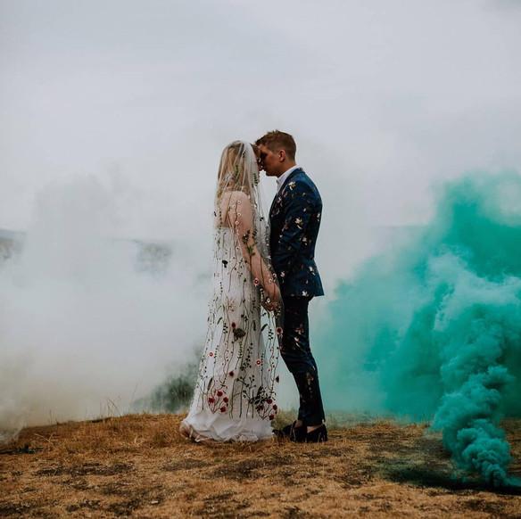 couple with blue smoke
