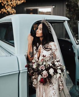 Boho bride near truck