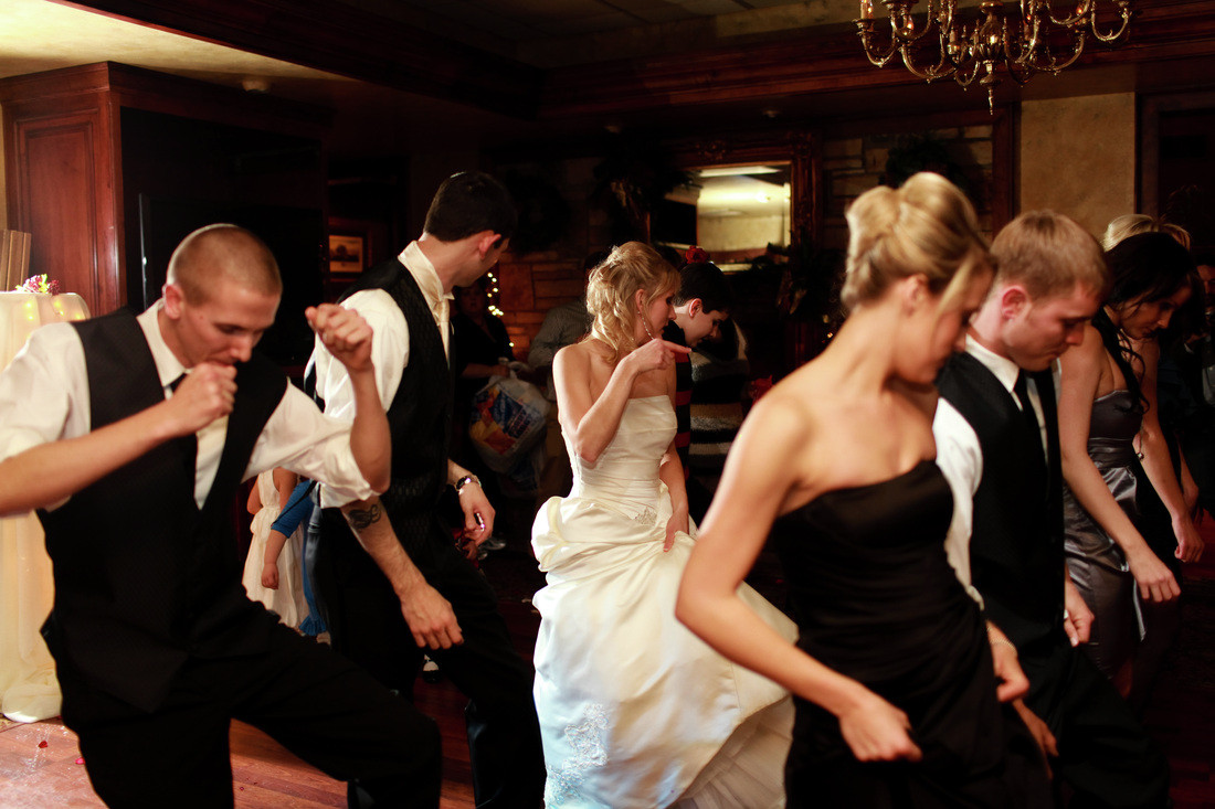 bride and groom group dance