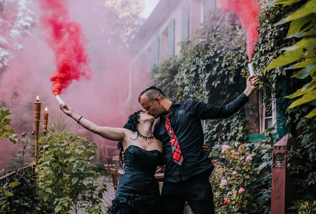 couple with red smoke