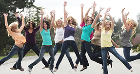 young women jumping for joy
