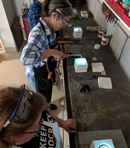 Students annealing their billets in the mini-furnace