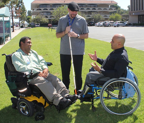 Peer-support-3-men-with-disabilities-tal