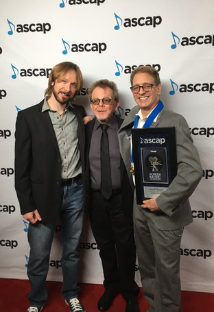 ASCAP award for top cable television series Loud House. Freddy Monday, Paul Williams & Phil Cimino.