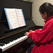 """A student playing """"Sonatina in F Major,"""" Op. 168, No.1 by Anton Diabelli."""