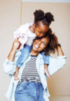 adorable%20sweet%20young%20afro-american%20mother%20with%20cute%20little%20daugh_edited.jpg