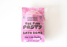A pink bath bomb in the shape of a pasty with all natural ingredients, made by a small business in Cornwall