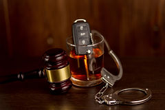 Whiskey with car keys and handcuffs. Con