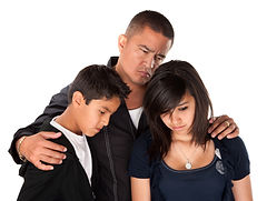 Hispanic father with kids looking down a