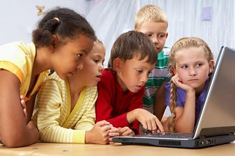Kids staring at a computer screen