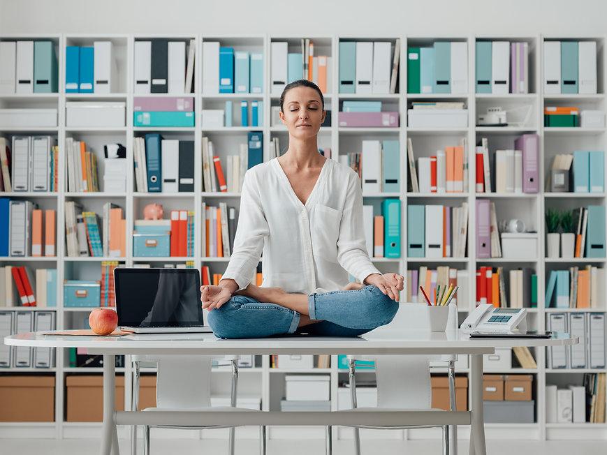 woman-practicing-meditation-on-a-desk,  self-care