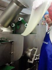 Sean Ferry stretching Mozzarella cheese