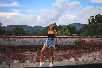 Girl outside brick wall