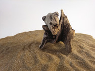 """Desert Hero"", found tree pieces, sand and playwood, 2020"