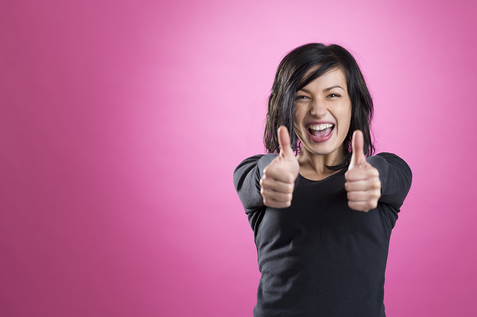 Excited, happy girl giving thumbs up showing success, isolated on pink background..jpg