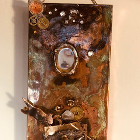 """Angel Cat looking for Salvation in a Dumpster from the Angel Cat series of cats looking out for others, Mixed media, copper, brass, mirror, clock parts.  4"""" x 7"""