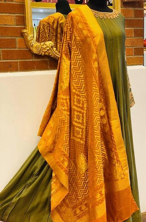 Mehndi green Anarkali comes with mustard yellow zari dupatta