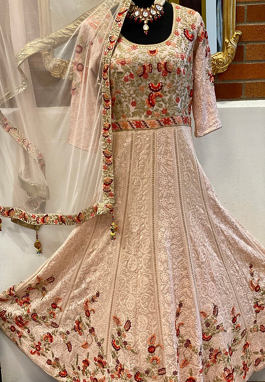 Striking light pink Anarkali with alluring embroidery to enhance the grace in yo