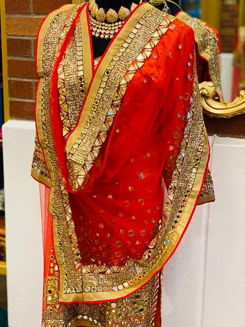 Real mirror work orange kurta with red patiyala .