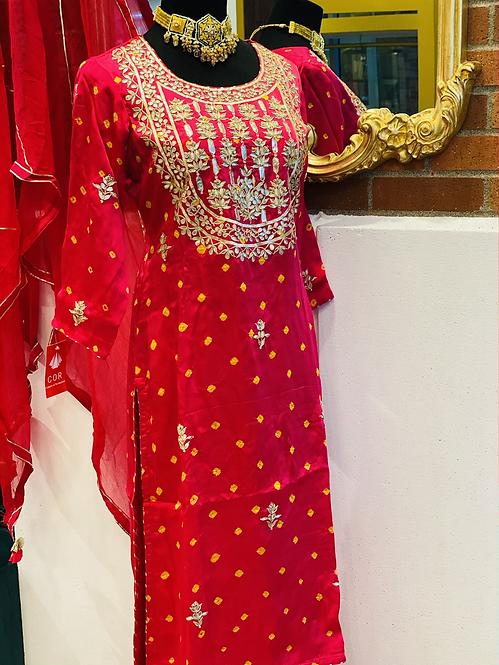 Pure gajji silk suit with gotta patti work on neckline comes with sharara