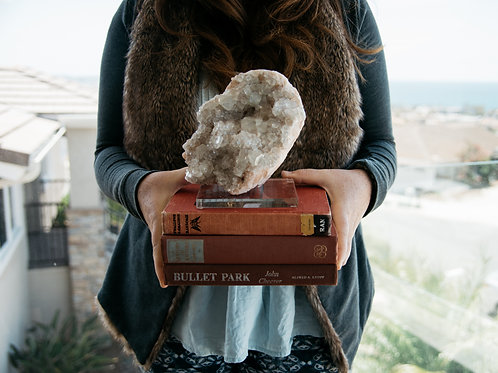 CURATED CRYSTAL + STACK OF BOOKS