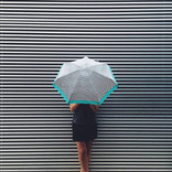 The girl with the striped umbrella