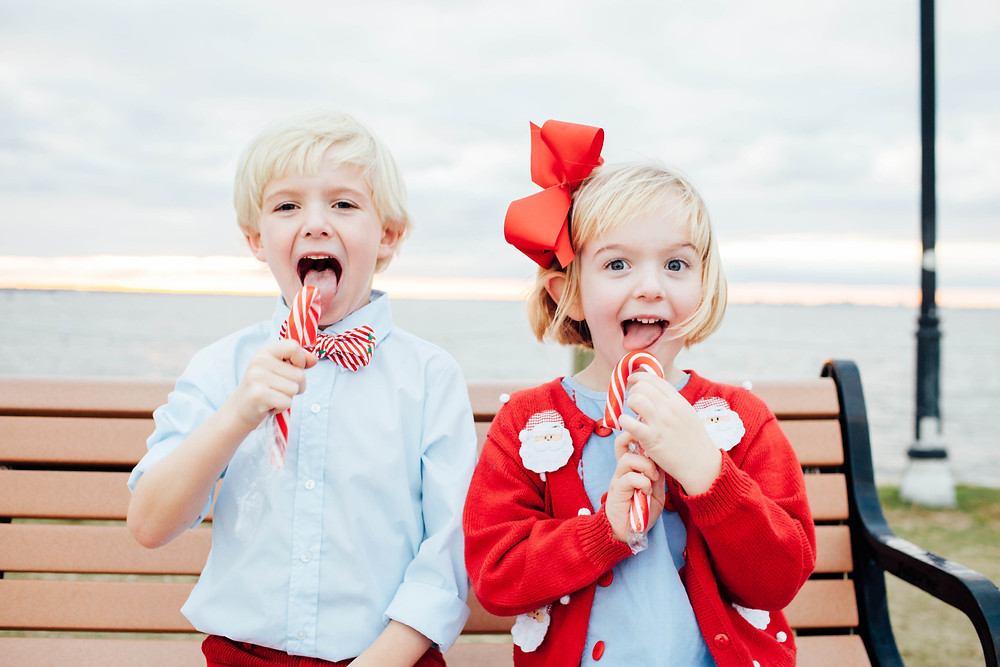 brother and sister eat candy canes in family photoshoot