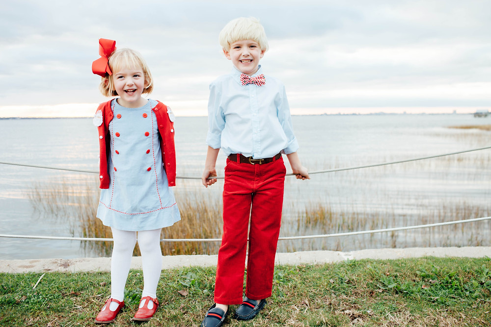 brother and sister smile of family christmas card picture