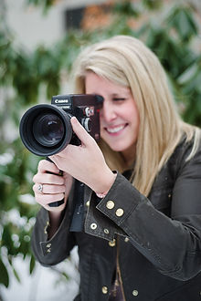 close up headshot of caitlin holding video camera
