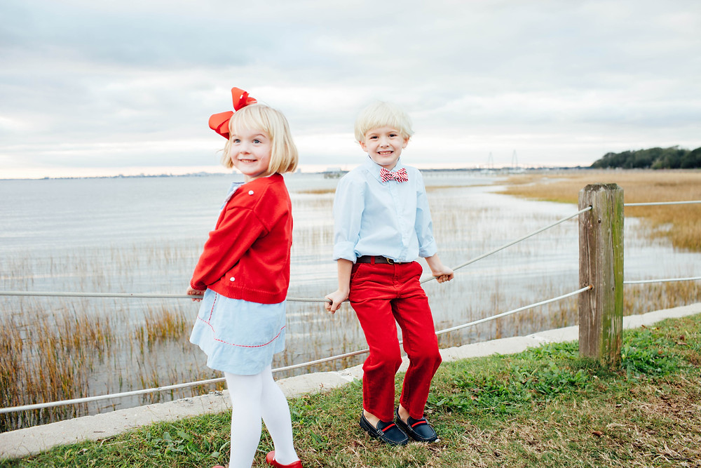 siblings pose for christmas picture on the mount pleasant old bridge