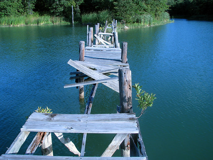 Broken wooden  bridge after disaster ove