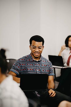 NYU CAC male adviser wearing glasses.