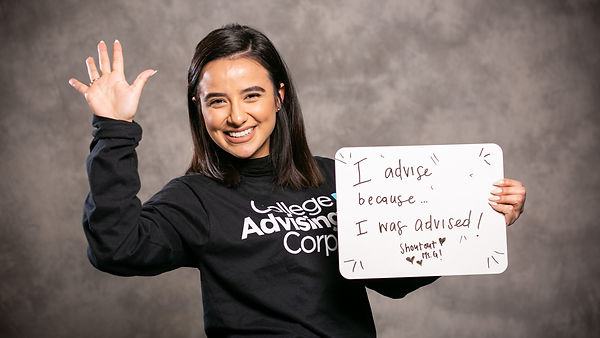 "Saskya Molina holding a ""why I advise"" sign at Summit."
