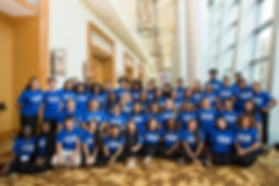 NYU CAC advisers at Summit all wearing blue College Advsing Corps shirts in a group shot.