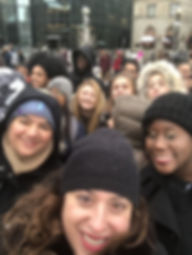 Group of NYU CAC advisers and staff standing in coats and hats outside in Boston during Summit.