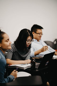 Three NYU CAC advisers sitting in a classroom.