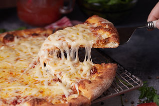 Close up pizza and stretched cheese.jpg