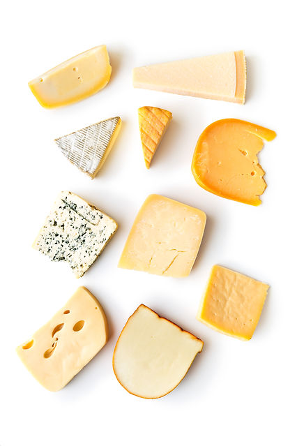 Different kinds of cheeses isolated on w
